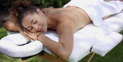 Grinning woman resting on massage table Stock Footage