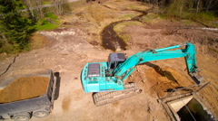 The backhoe digging the soil in the forest - stock footage