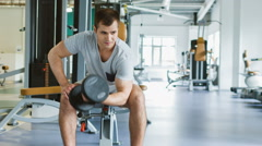 man makes exercises for the biceps in gym. sports and healthy concept - stock footage