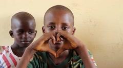 Africa native village school children make heart with hands Stock Footage