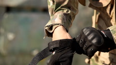 Man puts the military ammunition - stock footage