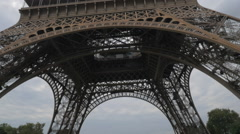 Woman with cellphone taking photo of Eiffel Tower Stock Footage