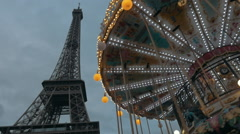 Eiffel Tower and vintage merry-go-round Stock Footage