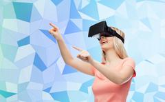woman in virtual reality headset or 3d glasses - stock photo