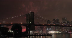 July 4th fireworks in New York City over Brooklyn Bridge - stock footage