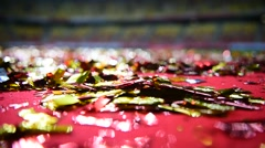 Colored confetti on the ground after celebration event - stock footage