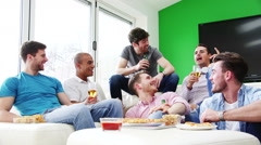 Men Enjoying Pizza And Beer Stock Footage