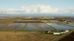 Aerial view of commercial rice growing fields Northern California Stock Footage
