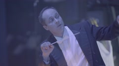 Male conductor conducts the orchestra Stock Footage
