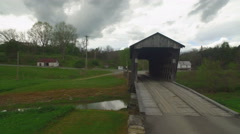Aerial of Covered Bridge, Church, Creek, and Road in Rural Area Stock Footage