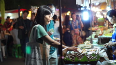 Night temple market at Loi krattong festival Thailand tourist shopping Stock Footage