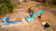 The 360 degrees aerial view of the backhoe and the forest - stock footage