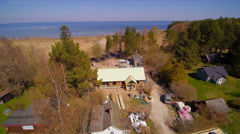 The aerial view of the cabin house with wooden roof Stock Footage