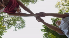 Low angle view of young attractive women spinning and playing Stock Footage