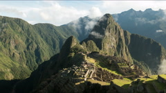 Zoom in morning time lapse of machu picchu on a misty morning Stock Footage