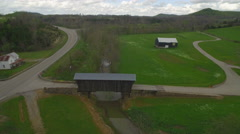 Aerial of Covered Bridge, Barn, Creek, and Road in Rural Area Stock Footage