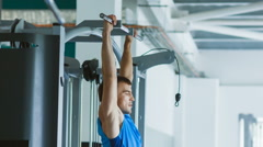 Sporty young man doing exercise at the gym Stock Footage