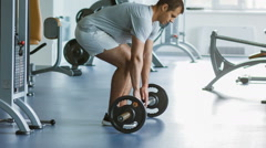 Muscular Man Lifting Deadlift In The Gym. sports and healthy concept Stock Footage