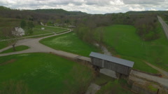 Aerial of Covered Bridge, Creek, Church, and Road in Rural Area Stock Footage