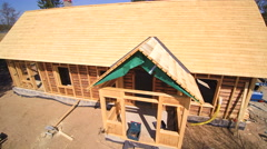The newly constructed wooden house in the park Stock Footage