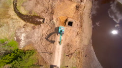 Aerial view of the truck and the backhoe - stock footage