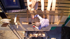A roofer installing the shingles on the roof Stock Footage