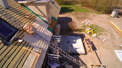 A roofer man climbing the ladder Stock Footage