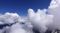 Cloud formations whirl at mountain top, high altitude, time lapse Stock Footage