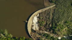 Aerial view of water dam providing power and energy in California Stock Footage