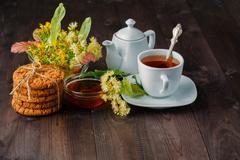 Linden flowers, herbal medicine, Cup of healthy linden tea Stock Photos