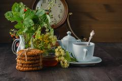 Useful linden tea in cup branches linden flowers and leaves Stock Photos