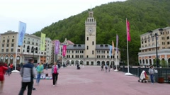Tourists scurry around central square, Roza Khutor village, time lapse Stock Footage