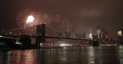 July 4th fireworks in New York City over Brooklyn Bridge Stock Footage