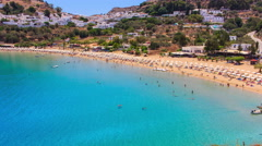 People on the beautiful Main beach in Lindos on Rhodes Island, Aegean Sea Stock Footage