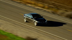 Aerial view of sedan car driving on highway Northern California Stock Footage