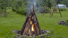 The firewoods on fire on the yard Stock Footage