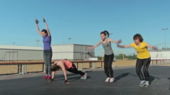 Girls doing burpee exercise, and another exercise Stock Footage
