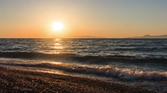 Sunset over the sea and islands in distance Greece Rhodes summer Stock Footage