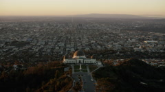 Sunrise aerial view over Griffith Observatory Los Angeles California Stock Footage