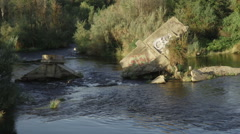 Close up of Destroyed concrete bridge fallen in river in Fresno California Stock Footage