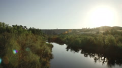 Horizontal pan shot of river leading up to a dam in Fresno California Stock Footage