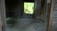 A ruined bunk house with rocks Stock Footage
