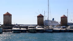 Medieval windmills at Mandraki Harbour in the Dodecanese island of Rhodes Stock Footage