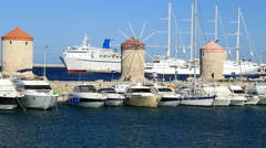 Windmills in the port to Rhodes Stock Footage