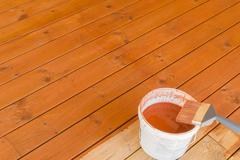 Painting the porch with pigmented oil Stock Photos