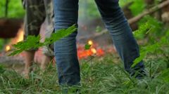 Man Stirs the Coals People Going Walking on Coals at Pagan Festival of Ivan Stock Footage