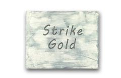 Motivational phrase note, Strike Gold sign - stock illustration