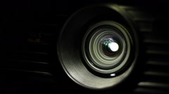 Cinema projector lens with playing video light Stock Footage