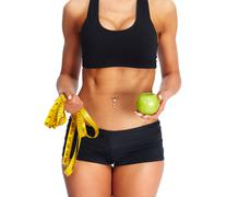 Woman abdomen with measuring tape and apple. Stock Photos