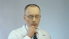 Emotions on male scientist's face, thinking on project, satisfied with good idea Stock Footage